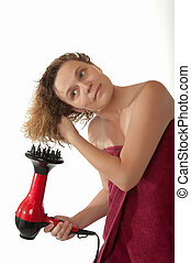 Woman drying hair after shower - Mature woman in her...