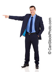 young businessman pointing - cheerful young businessman...