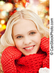 smiling teenage girl in red mittens and scarf - winter,...