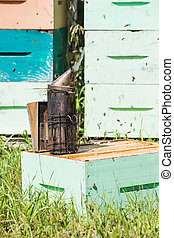 Bee Smoker At Apiary - Closeup of bee smoker on crate at...