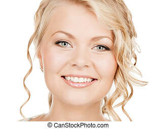 face of happy woman with long hair - health and beauty...