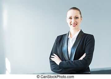 young modern business woman, crossed her arms and smiles