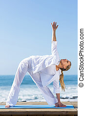 middle aged woman yoga on beach - pretty middle aged woman...