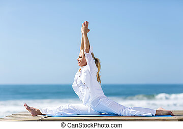 middle aged woman yoga outdoors - peaceful middle aged woman...