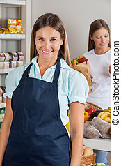 Saleswoman With Female Customer In Background