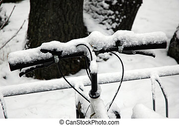 Handle bar in snow - A handle bar of a mountain bike is...