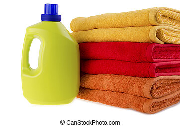 Detergent and towels isolated on white background.