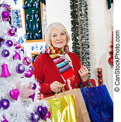 Beautiful Woman With Shopping Bags At Store - Portrait of...
