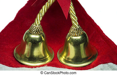 Real christmas bells on red cloth and white background.