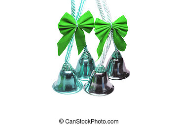 Four real christmas bells with green ribbon bow on white...