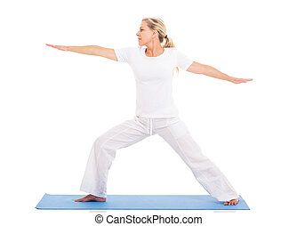 middle aged woman practicing yoga - healthy middle aged...