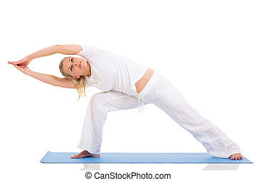 mid age woman doing yoga exercises - flexible mid age woman...