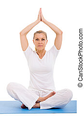 senior woman yoga meditating