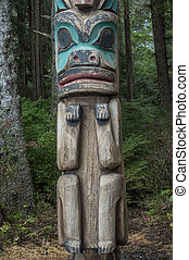 Tlingit culture - Low man on a wooden cedar Tlingit totem...