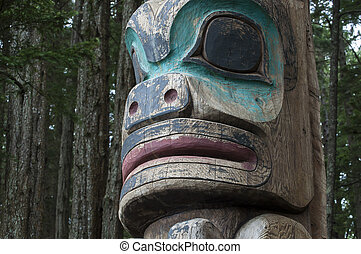 Totem pole - Closeup of face of wooden Tlingit totem pole in...