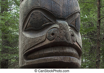 Tlingit totem pole - Closeup of face on wooden cedar Tlingit...