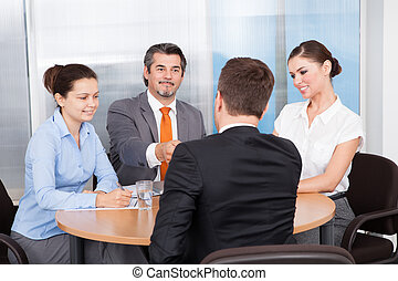 Businesspeople Taking Interview - Businesspeople Conducting...
