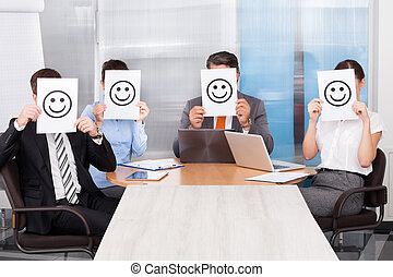 Businesspeople Holding Smiley Icon - Group Of Businesspeople...