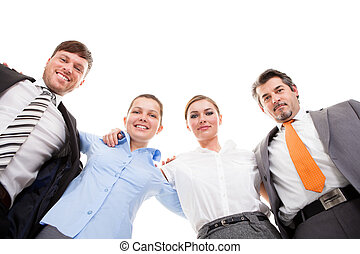 Huddle Of Happy Businesspeople - Low Angle View Of...