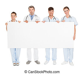 Doctors Holding Placard - Group Of Doctors Holding Blank...