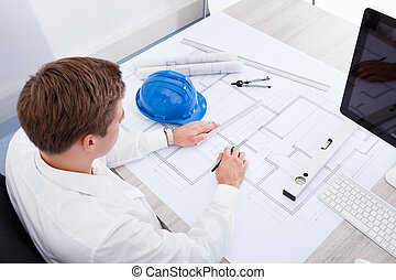 Architect Drawing On Blueprint - Portrait Of A Young...