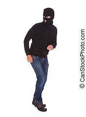 Portrait Of A Burglar Standing Isolated On White Background