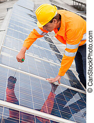 Engineer Adjusting Solar Panels - Male Engineer Adjusting...