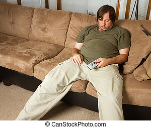 Guy passed out on the couch - Obese guy sitting on the couch...