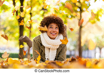 Autumn outdoor portrait of beautiful African American young...