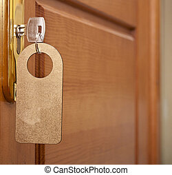 key in keyhole with blank golden label
