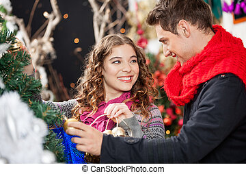 Happy Couple Shopping For Christmas Tree - Happy young...