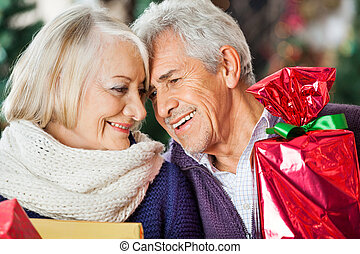 Loving Couple With Christmas Presents In Store