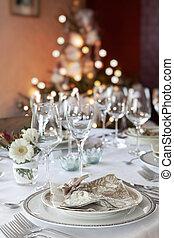 Christmas dinner table in white