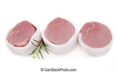 veal tournedos in front of white background