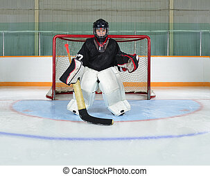 Young Kid Goalie In Hockey Net Crease - A Young Hockey...