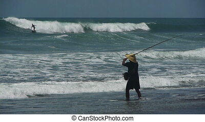 Fishing from the beach, Bali, Indonesia