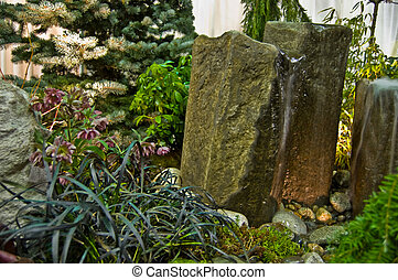 Rock Fountains with Water in Garden Setting - Rock fountains...