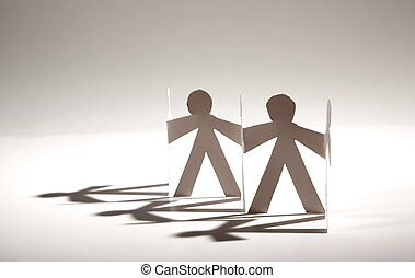 Paper Dolls - Line of cutout paper dolls throwing a shadow