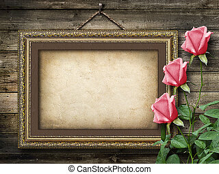 Old vintage frame for photos and a bouquet of yellow roses -...
