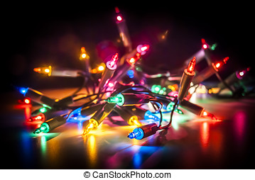 Fairy Lights - Christmas fairy lights isolated on reflecting...