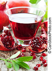 pomegranate juice - fresh ripe pomegranate and juice in the...