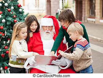Children And Santa Claus Reading Book