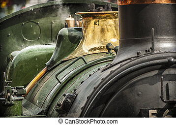 Steam Train Detail - Background of a green steam engine at...