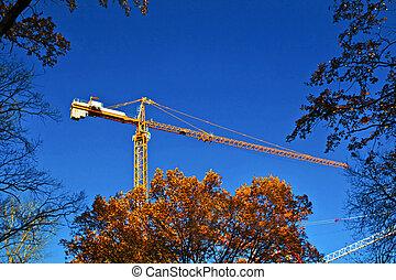 A construction crane. - A construction crane at a...