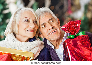 Couple With Christmas Presents In Store