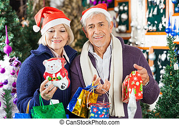Man Shopping For Christmas With Woman In Store - Portrait of...
