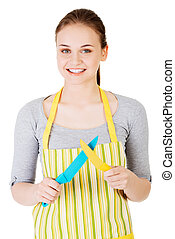 Attractive woman in kitchen apron with knives Isolated on...