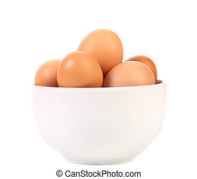 Bowl with brown eggs. Isolated on a white background
