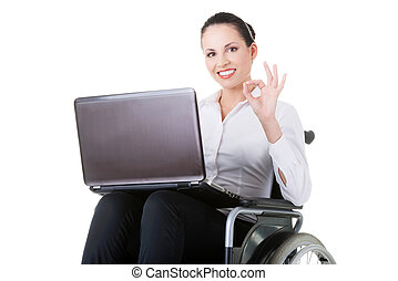 Business woman sitting on wheelchair, showing OK. Isolated...