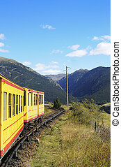 Little Yellow Train in the Pyrenees Mountains, France - The...